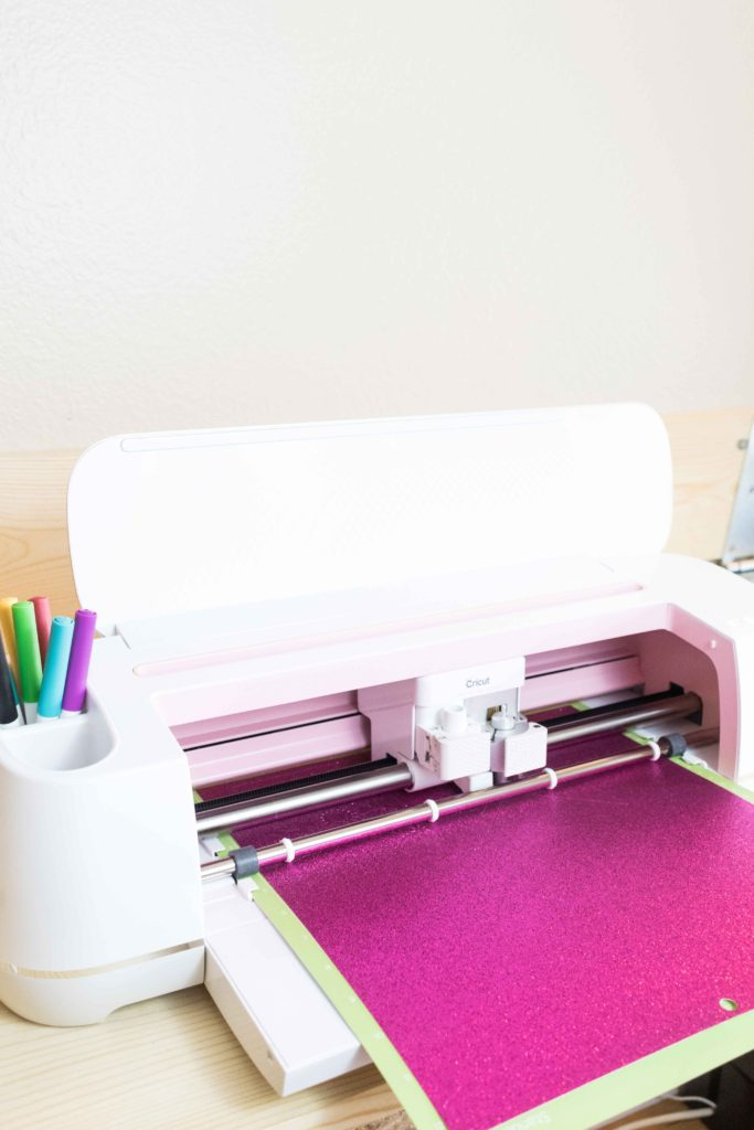 Load Mat and tools to your Cricut to cut glitter cardstocl