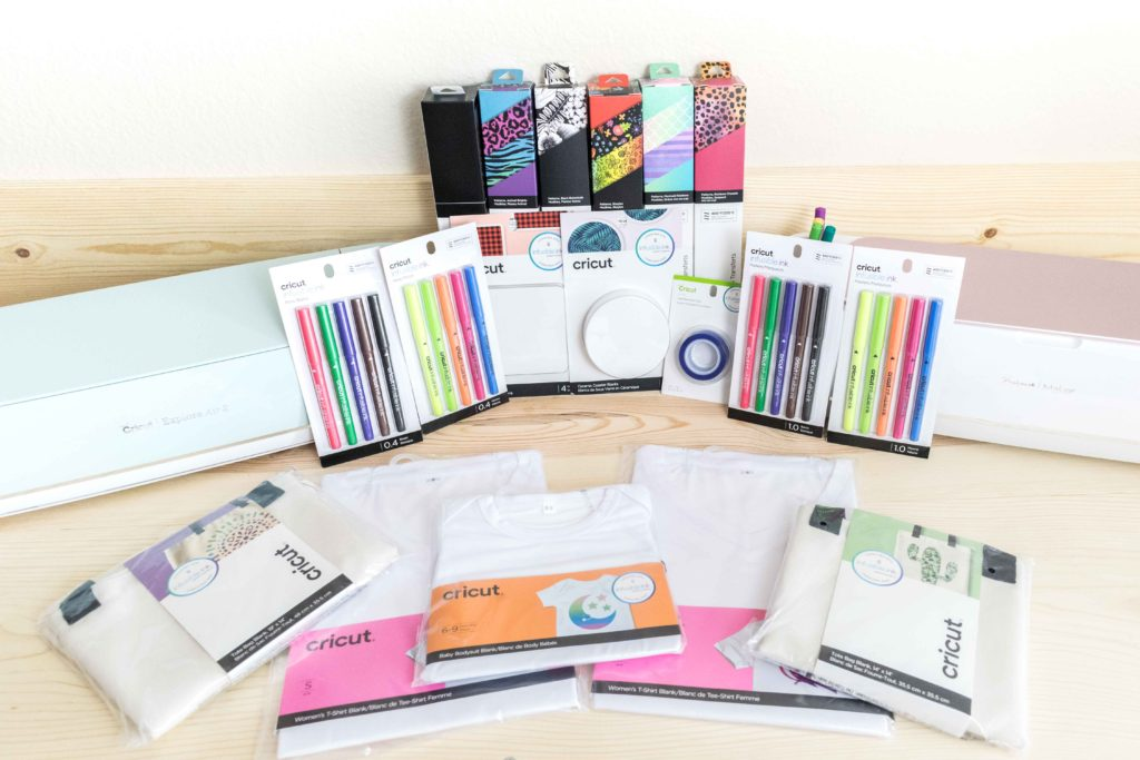 Display of Cricut Maker and Explore with Infusible Ink Product Lines (Transfer sheets, totes tshirts, pens, coasters, transfer tape, etc)