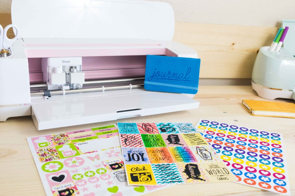 Cricut Maker and Explore with three different sticker sheets