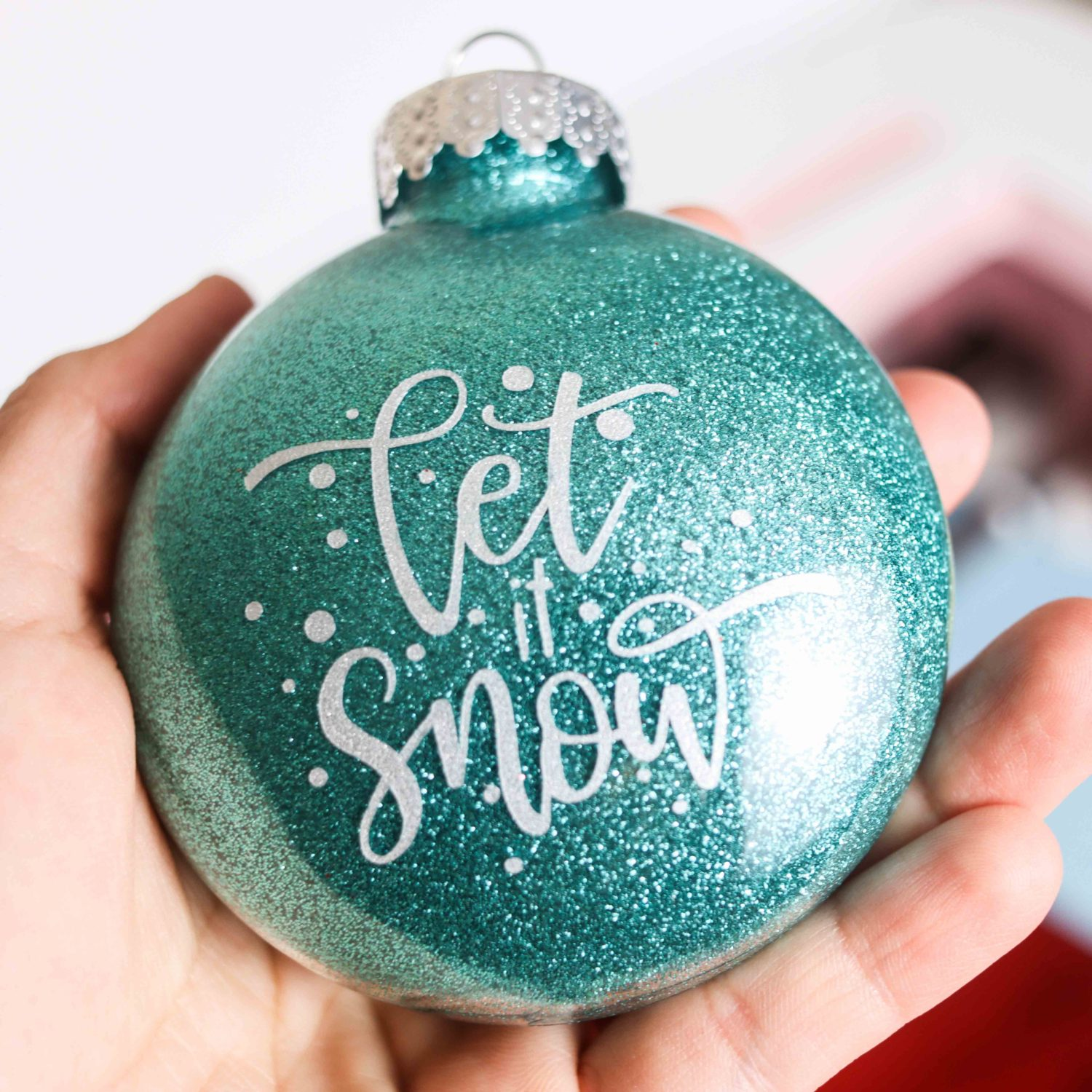 "blue glitter Christmas Ornament with ""let it snow"" phrase"