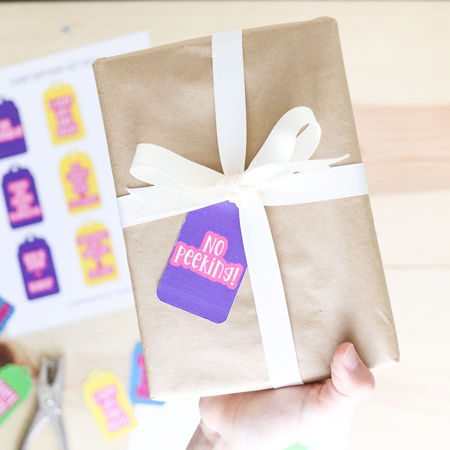 Wrapped present with a funny birthday gift tag