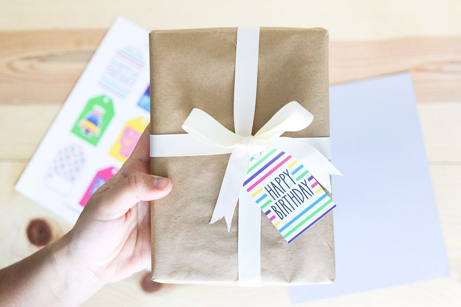 Wrapped present with a colorful birthday gift tag