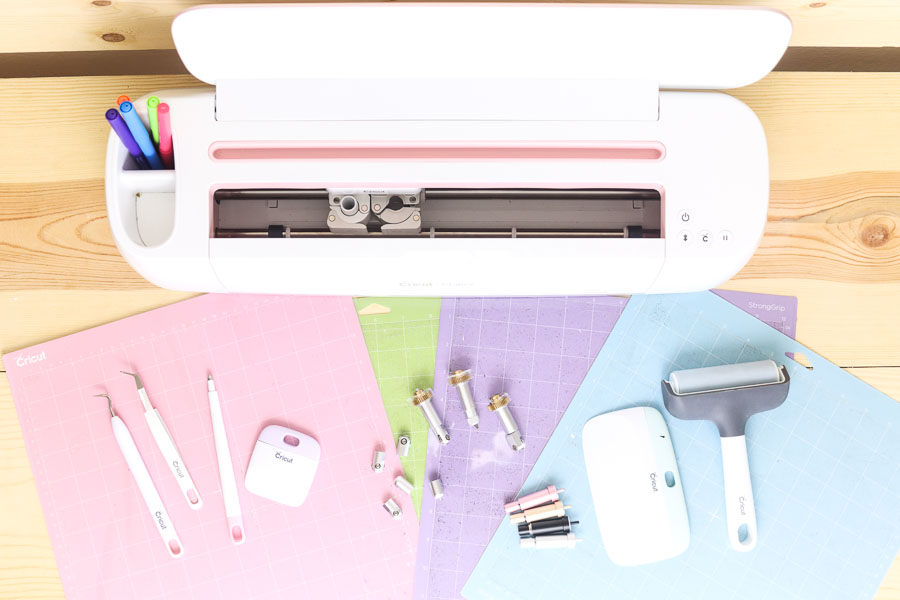 Cricut Maker with blades, mats and weeding tools.