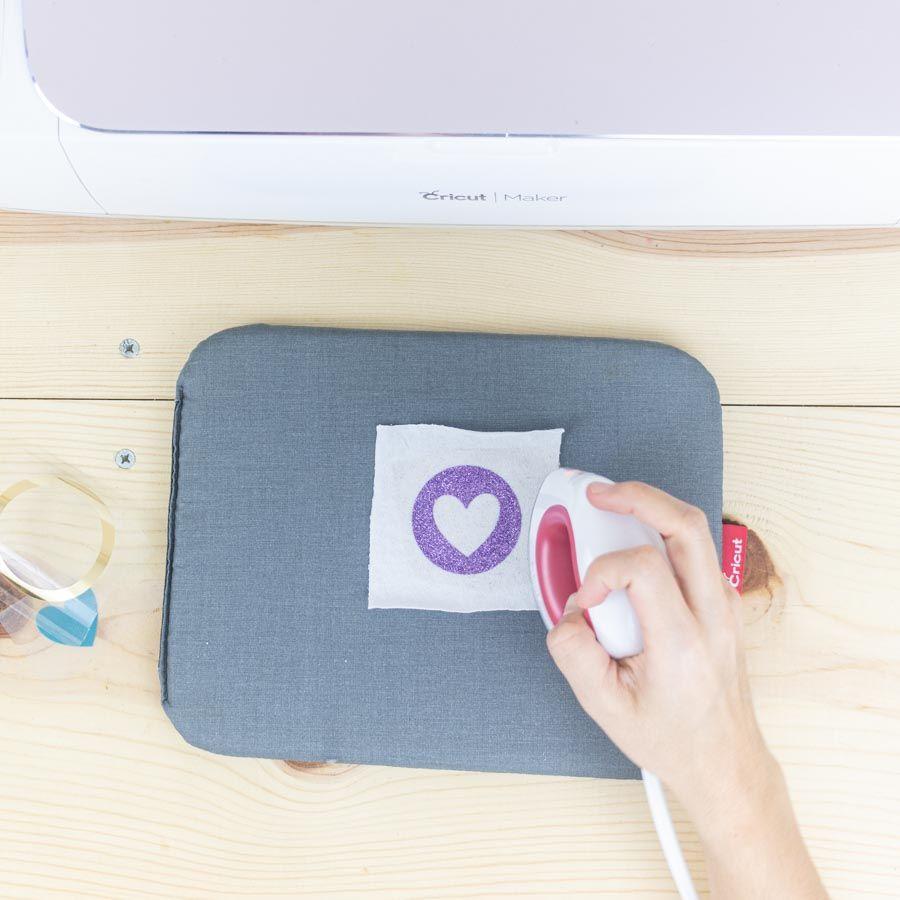 Pressing Glitter Iron-On on fabric