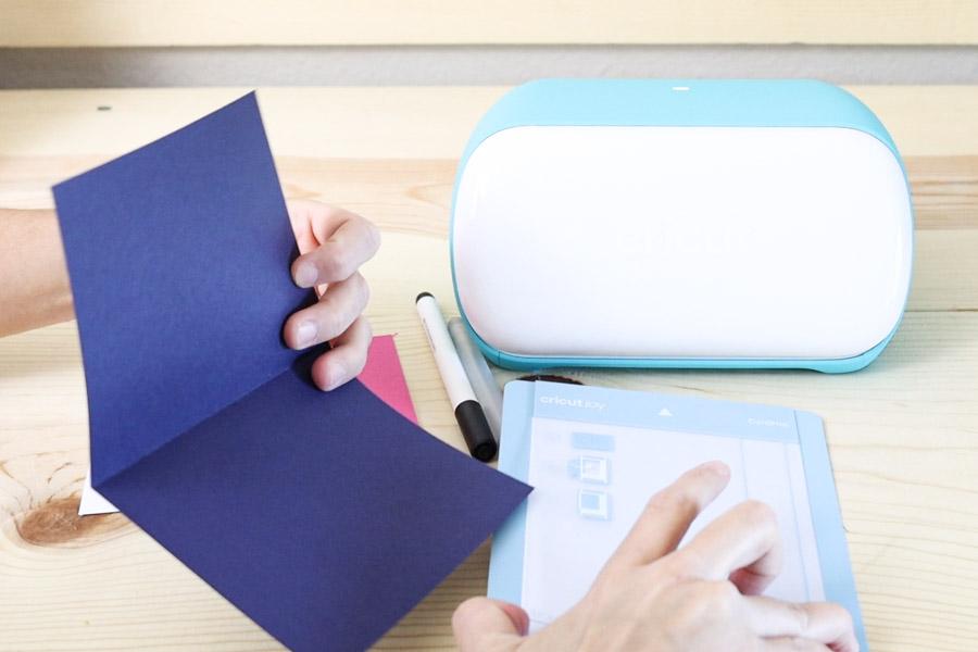 Placing insert card inside cricut joy card mat