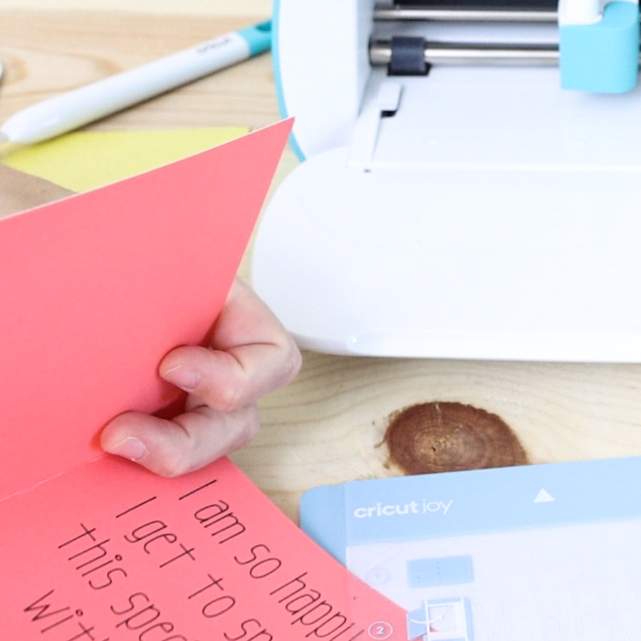 inserting card on card mat to cut