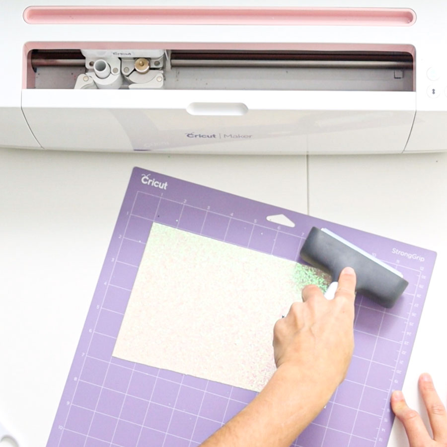 using the brayer to place material on cricut mat