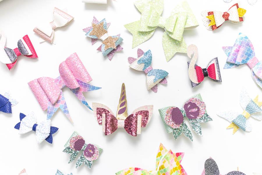 variety of hair bow made with the Cricut. Swan, Mermaid, fairy, etc.