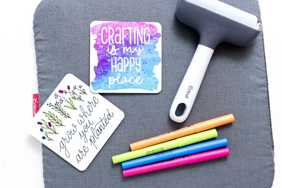 cork coasters made with cricut infusible ink, brayer and infusible ink pens